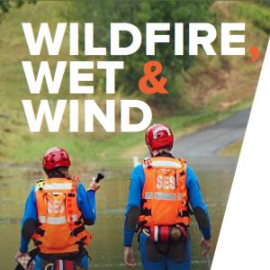 two SES volunteers in flood waters