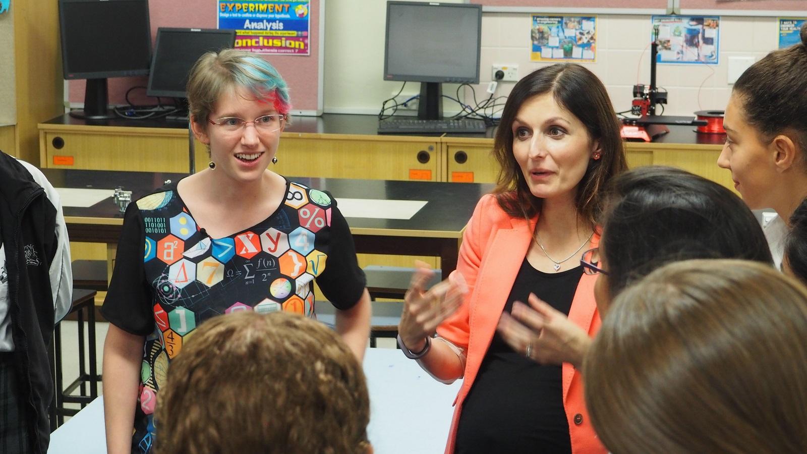 Nicky Ringland and Muireann Irish speaking with school girls