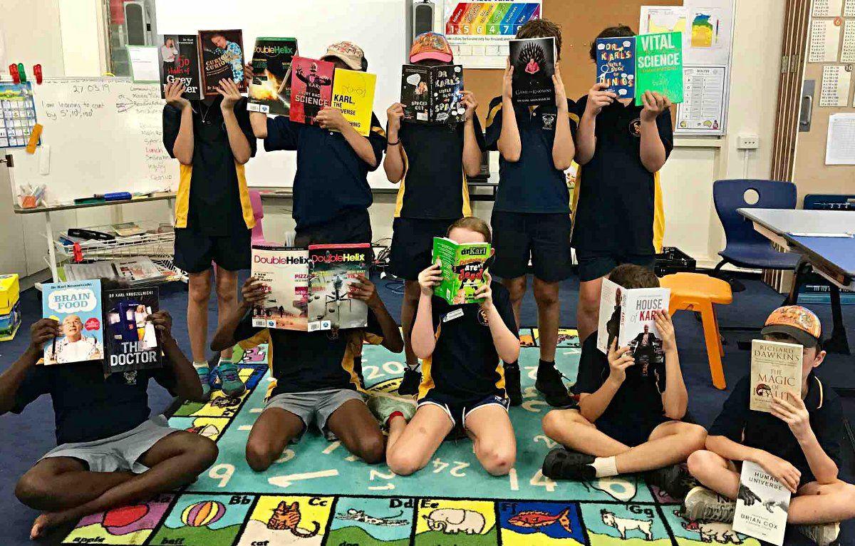 school students reading books