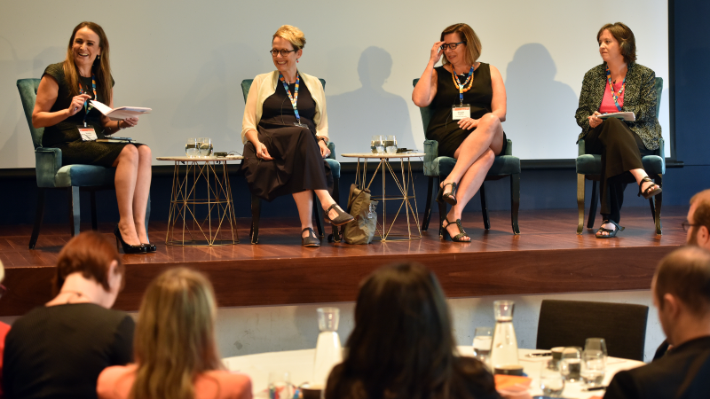 a panel of female speakers at an STA event